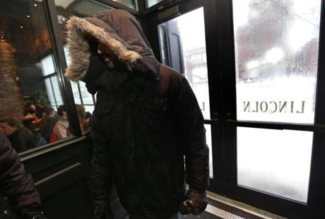 Boston, MA - 06/08/12 - A customer comes in out of the cold as he enters the Lincoln Tavern and Restaurant in South Boston. Lincoln Tavern and Restaurant in Southie was doing a thriving business as locals crowded the establishment despite today's blizzard. - (Globe Staff Photo / Barry Chin), section: Business, reporter: Andrew Caffrey, slug: 09StormBars, LOID: 5.1.606493675.