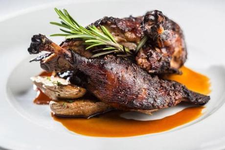 Rialto's slow-roasted Long Island duck with braised escarole is served with Sicilian olives and fingerling potatoes.