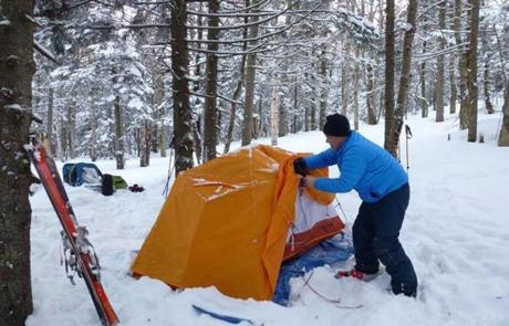 The sunny tangerine tent had crossed poles to stabilize against wind and heavy snow.