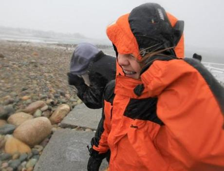 Scituate ,Massachusetts 02-08-2013 Jake Casey (cq) left and Max Hirsch (cq) right struggle in the high winds near the Scituate Lighthouse. Scituate Blizzard coverage . ( Jonathan.Wiggs )Topic:Section:Reporter: Topic: Reporter: