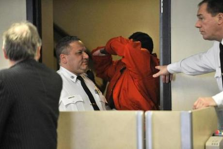 Michael Stallings hid his face at his arraignment on murder and assault charges in Suffolk Superior Court.