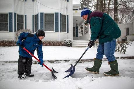 02/08/2013 NEWBURYPORT, MA Michael Tilley (cq) 8 (left), helped his grandfather Scott Tilley (cq) shovel the sidewalk as a winter storm, expected to dump as much as 24 inches of snow in the region, intensified in Newburyport. (Aram Boghosian for The Boston Globe)
