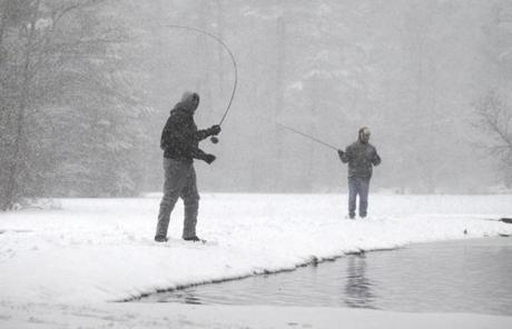 Norfolk, MA - 2/8/13 - l-r John Lambert (cq) and George Bentley (cq) fly fish in the snow. (Globe staff photo / Bill Greene) section: metro, topic: 09storm