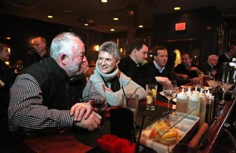 Even on a Tuesday night, The Local in Newton was crowded - with a 45 minute wait for a table early in the evening. Earl Hinkley, left, and Patti Sclafani-Hinkley, Wellesley, at the bar.