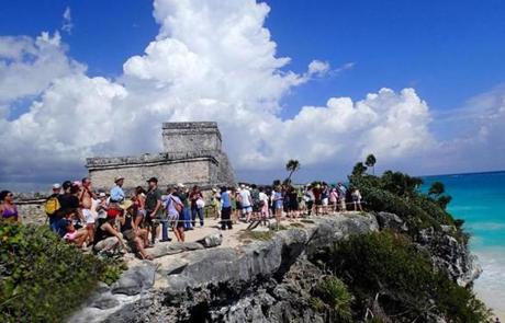 This ancient Mayan castle, or castillo, in Tulum, Mexico is perched on a bluff overlooking the Caribbean sea.