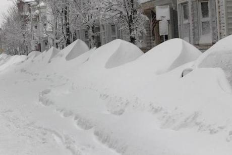 Snow entirely covered cars in South Boston.