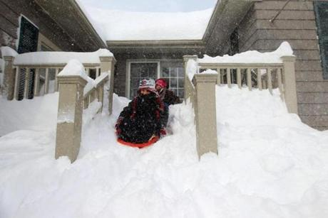 Shea, 6 and Sienna, 4, Brearley slid down their grandparents' front steps in Lexington.