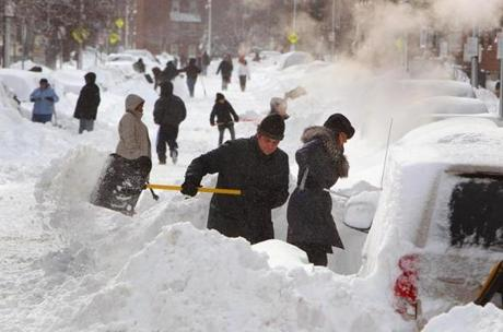 People dug out their cars on Shawmut Avnue in the South End.