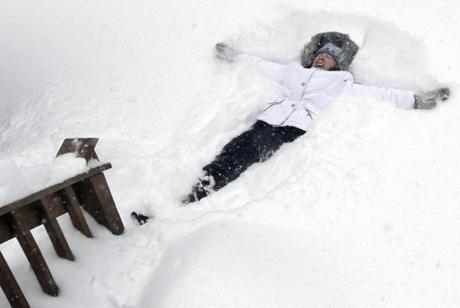 Nicole Lacoursiere of North Andover made a snow angel.