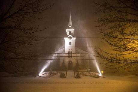 02/08/2013 NEWBURY, MA Two powerful lights illuminate First Parish Church of Newbury (cq) as a winter storm, expected to dump as much as 24 inches of snow in the region, intensified in Newbury. (Aram Boghosian for The Boston Globe)