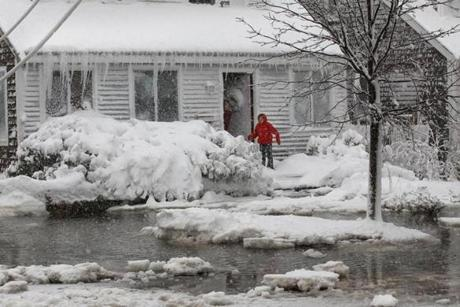 SCITUATE MA.02/09/13: Circled by water and ice on Turner Rd Schituate are Andrea Giacomozti and her daughter Gavin....Conditions after the storm ( David L Ryan/Globe Staff Photo ) SECTION: METRO TOPIC 10snowmain