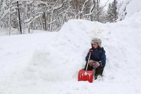 Danny Gray, 6, took a rest from shoveling in Newton.