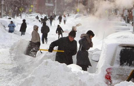 Residents on Shawmut Avenue in Boston dug out after the storm.