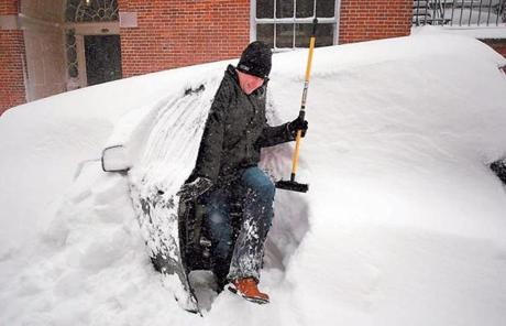 Aengus Mcallister emerged with his snow brush from his vehicle on Beacon Hill.