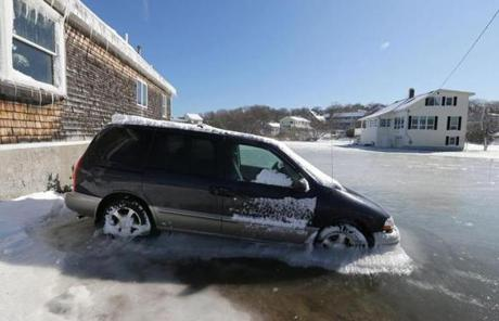 A vehicle was partly submerged in ice and water near Adduci Way in Hull.