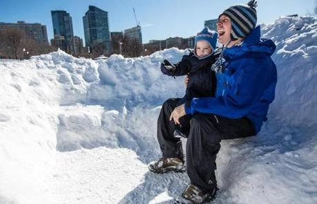 Joe Ciolino and his son, John, sat in a small snow fort in Boston Common.