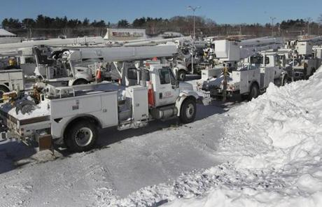 The parking lot of the Hanover Mall served as a staging area for up to 100 utility trucks on Sunday afternoon.