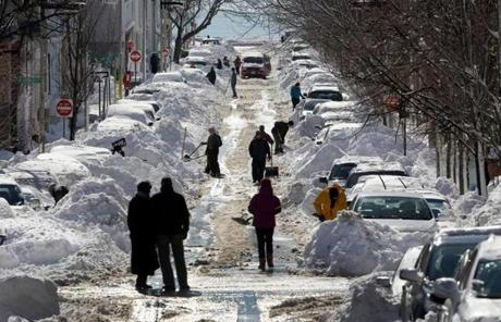 Residents on N Street in South Boston  shoveled out on Sunday afternoon.
