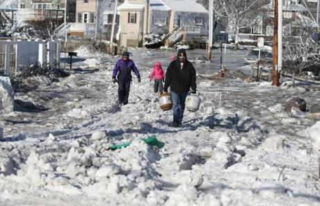 Ron Lund made his way with propane tanks on Otis Road in Scituate.