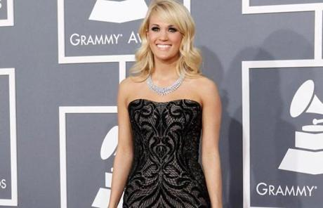 Carrie Underwood walked in wearing a Roberto Cavalli gown and 381 carats of diamonds.