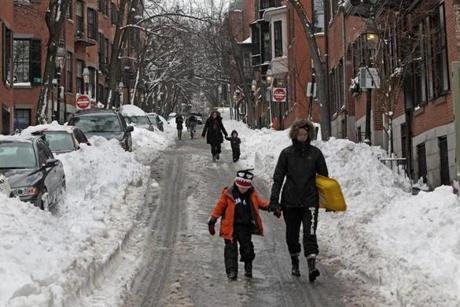 Pedestrians on Pickney Street on Beacon Hill found it easier to walk in the streets instead of on the sidewalks.