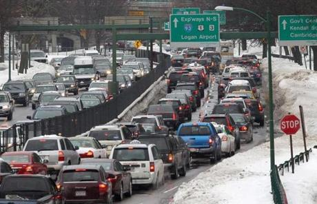 Traffic backed up as cars tried to navigate a snowy Storrow Drive.