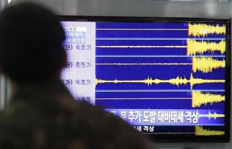 A South Korean soldier watched a TV screen reporting seismic waves from North Korea's nuclear test.