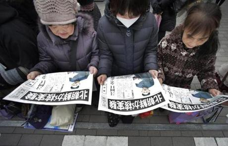 Women in Tokyo read copies of a Japanese newspaper reporting North Korea's nuclear test.