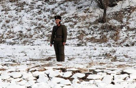 A North Korean soldier patrolled the river bank of the North Korean town of Sinuiju, opposite the Chinese city of Dandong.