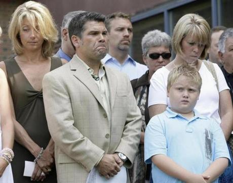 Station nightclub co-owner Jeffrey Derderian, second left, his wife Linda, top right, their son, Max, 8, bottom right, and Kristina Derderian, left, wife of nightclub co-owner and Jeffery's brother, Michael, listen to a prayer prior to a news conference Thursday, July 19, 2007, in Warwick, RI. Derderian announced the formation of The Station Education Fund, a charity that will benefit children who lost a parent in the Station nightclub fire. (AP photo/) Library Tag 07202007