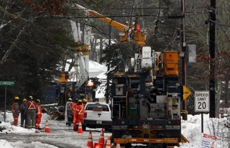 Utility crews were at work on Robinwood Avenue Monday in Buzzards Bay.