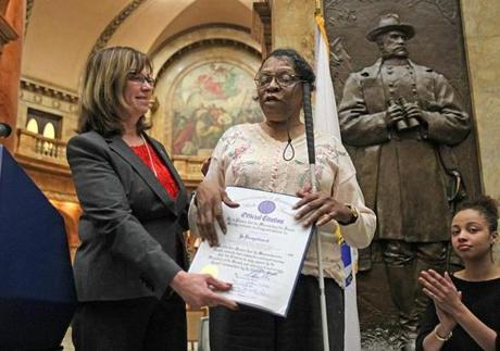 Senate President Therese Murray presented an award to Wilhelmina Melrose of the Mass. Senior Action Council in Roxbury during a ceremony to mark the 100th anniversary of Rosa Parks's birthday. Nine Massachusetts black women were honored for continuing Parks's fight for transit justice.