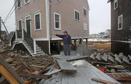 Joseph Spinzola in Scituate looked at debris after the storm.