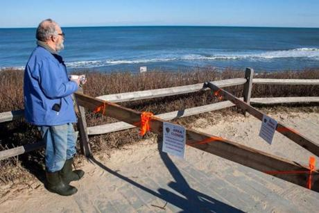 Cape Cod writer Bob Finch surveyed the beach landscape in Eastham.