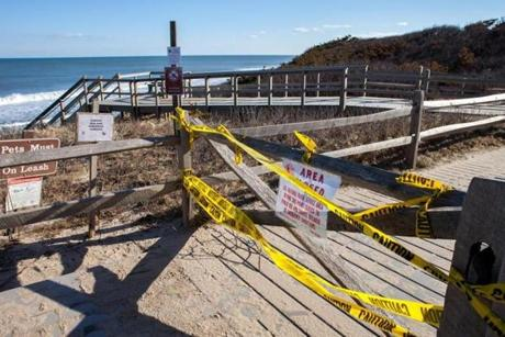 Yellow tape and signs indicated that Nauset Light Beach in was off-limits because of the storm damage.