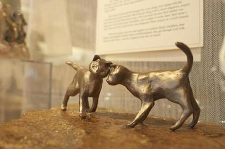 "Harvard resident Marilyn Jenney sculpted this bronze piece to express her love for cats for the ""Expressions of Love"" exhibit at the Handworks Gallery in Acton. Jenney, a self-proclaimed cat hoarder, tells the story of how she rescued and homed 28 cats and kittens."