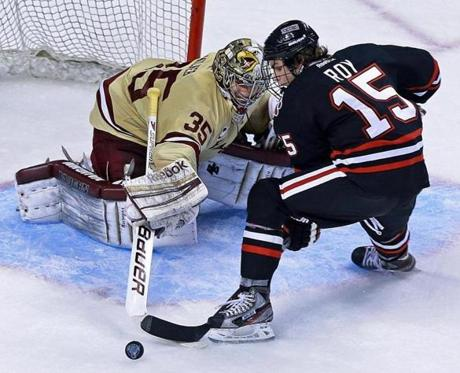 Boston College  goalie Parker Milner thwarted Kevin Roy's (15) bid for a Northeastern goal in the third period of the Beanpot Tournament at the TD Garden.