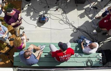 Manager John Farrell rested on a picnic table as he addressed reporters.