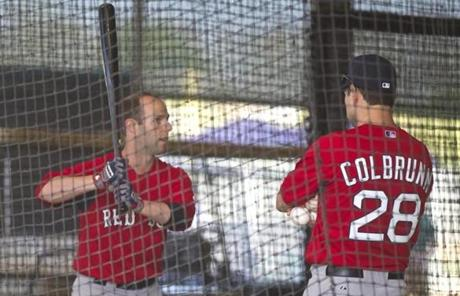 Dustin Pedroia worked with hitting coach Greg Colbrunn in the batting cage.