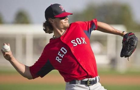Clay Buchholz, who hurt his hamstring Tuesday, did some long-tossing.