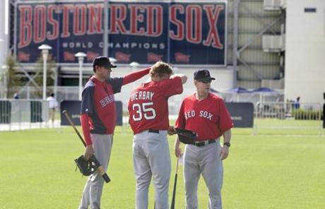 Minor league coach, Tom Kotchman, infielder Lyle Overbay and Brian Butterfield (left to right) surveyed the scene.
