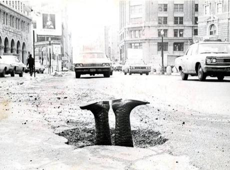 March 3, 1970: Likely a whimsical creation by the Associated Press photographer rather than a found situation, these upside-down boots provided a humorous depiction of falling knee-deep into a Boston pothole on Stuart Street.