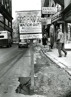 March 14, 1969: Local merchants advertised their displeasure at the failure of pothole repairs by the city on Bromfield Street in downtown Boston.