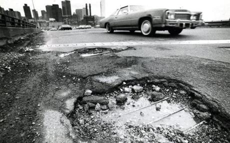 April 14, 1982: One of the many gaping potholes on the Southeast Expressway threatened traffic. The night before this picture was taken, two cars burst into flames after colliding when the first car lost a tire and had to brake. Both automobiles ignited in the crash, but all the occupants escaped safely.