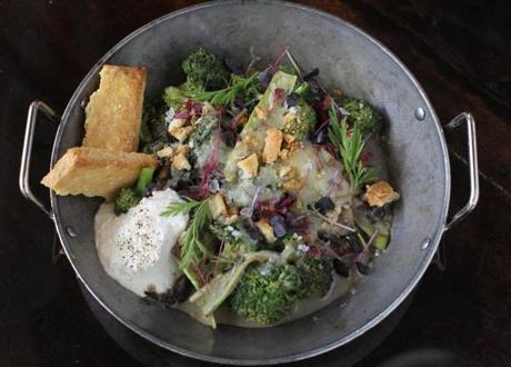 Broccoli casserole includes homemade crackers, wild mushrooms, and soft mounds of Comte cheese.
