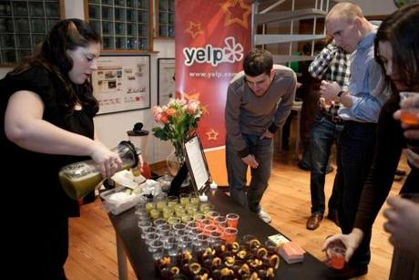 Meaghan Sinclair (left) of Booze Epoque served samples of specialty cocktails.