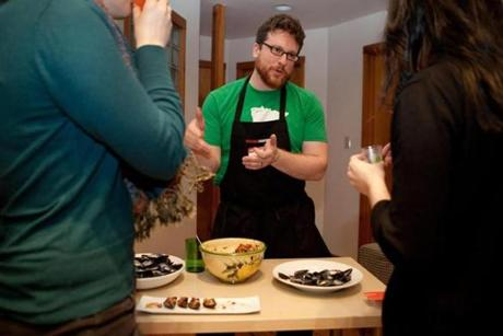 Ryan Redmond, chef at Field to Fork, explained the mussel salad dish he was serving.