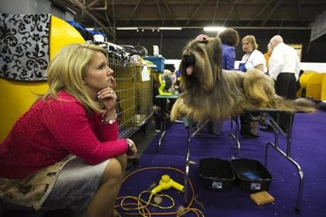 Jamie Danelson sits in the staging area with her Briard, Cumano of the Coastline.
