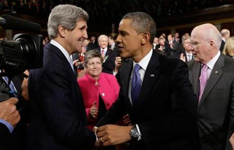 President Obama greeted Secretary of State John Kerry.