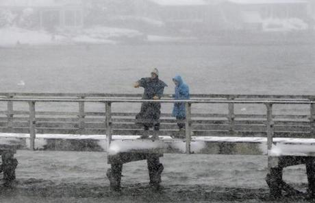 Walkers braved the footbridge across Lobster Cove in the Annisquam neighborhood of Gloucester.